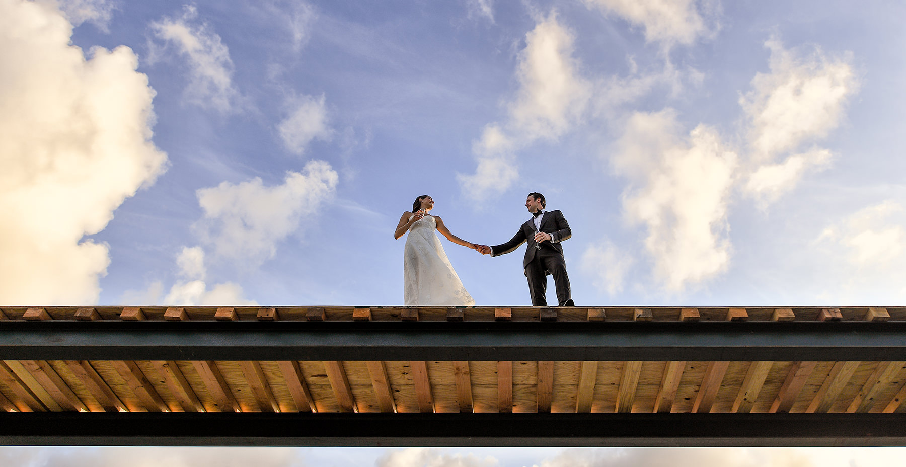 bride and groom under sky