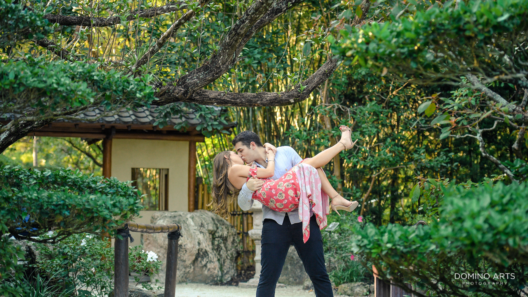 Fun kissing picture at Morikami Museum and Japanese Gardens Engagement photo session
