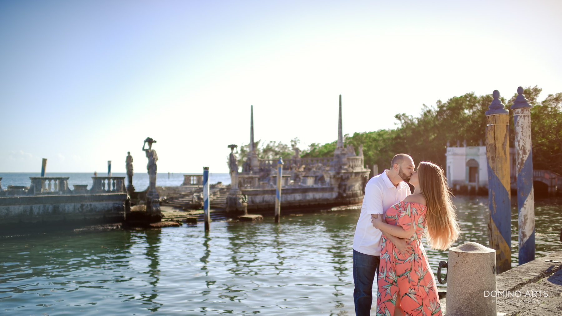 Kissing at Fun Luxury Engagement Photography at Vizcaya Museum & Gardens
