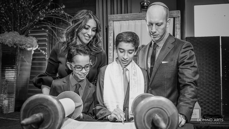 Family reading Torah at Mitzvah