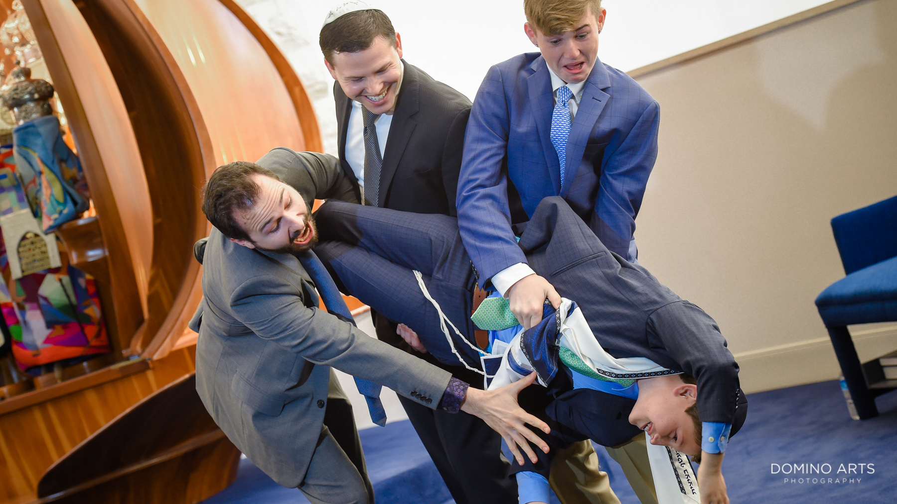 fun family pictures at mitzvah ceremony at temple beth el