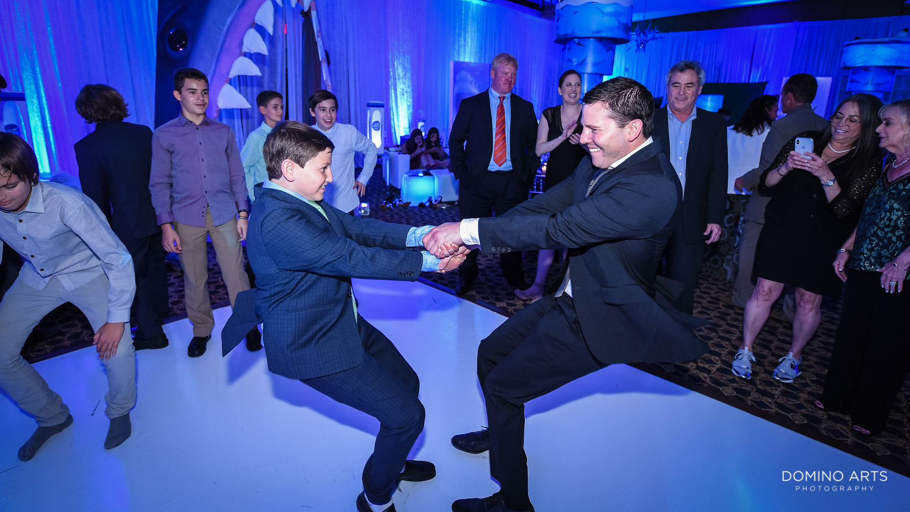 hora and dancing Fun party pictures at unique shark theme mitzvah at temple beth el