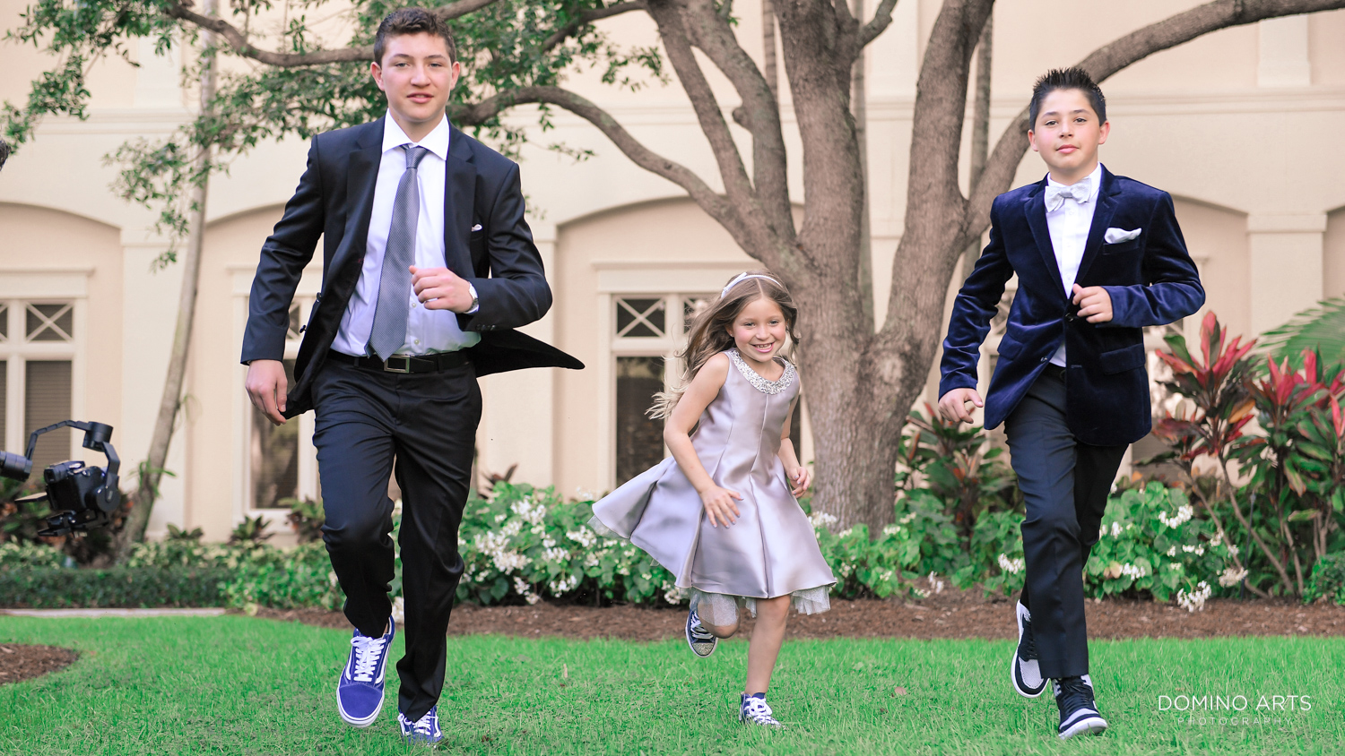 Unique and trendy Bar Mitzvah fun family photos at Woodfield Country Club Boca Raton