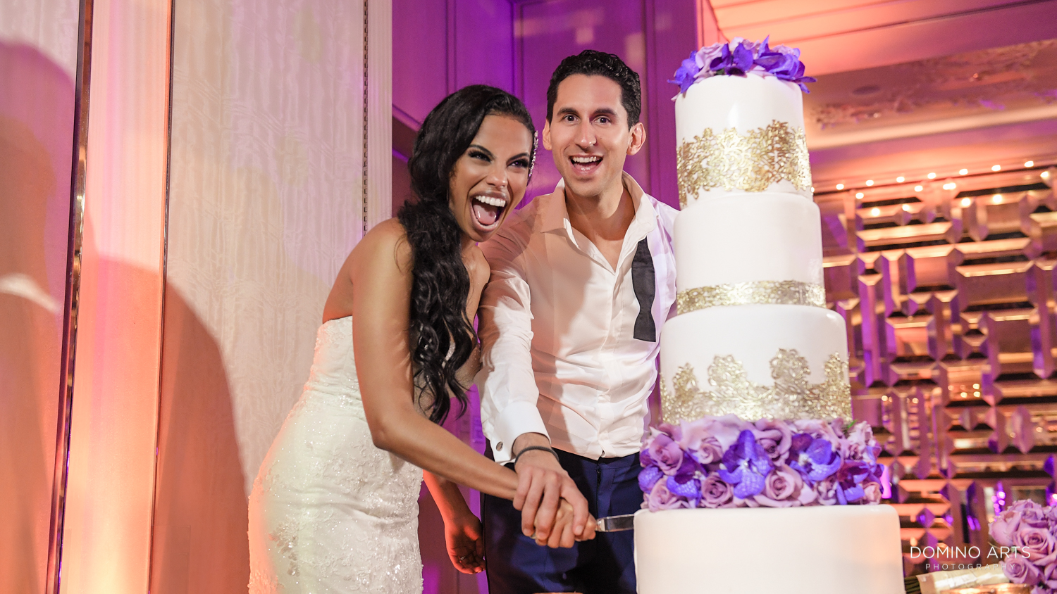 Bride and groom cutting cake at The St. Regis Bal Harbour