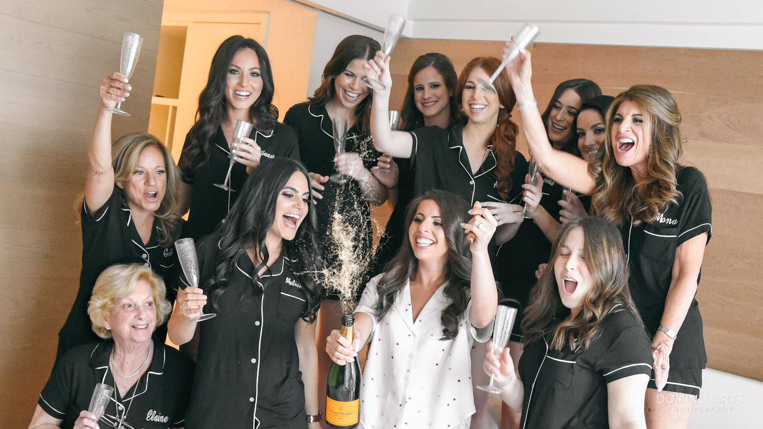 Fun wedding picture of bridesmaids getting ready at The Miami Beach Edition