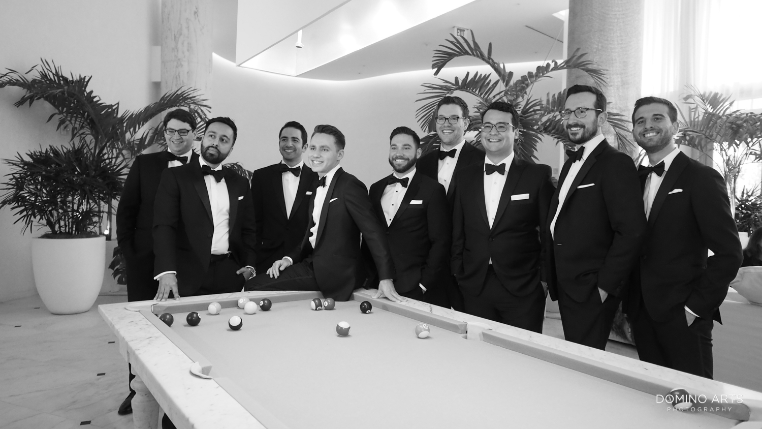 Cool wedding picture of groomsman at The Miami Beach Edition