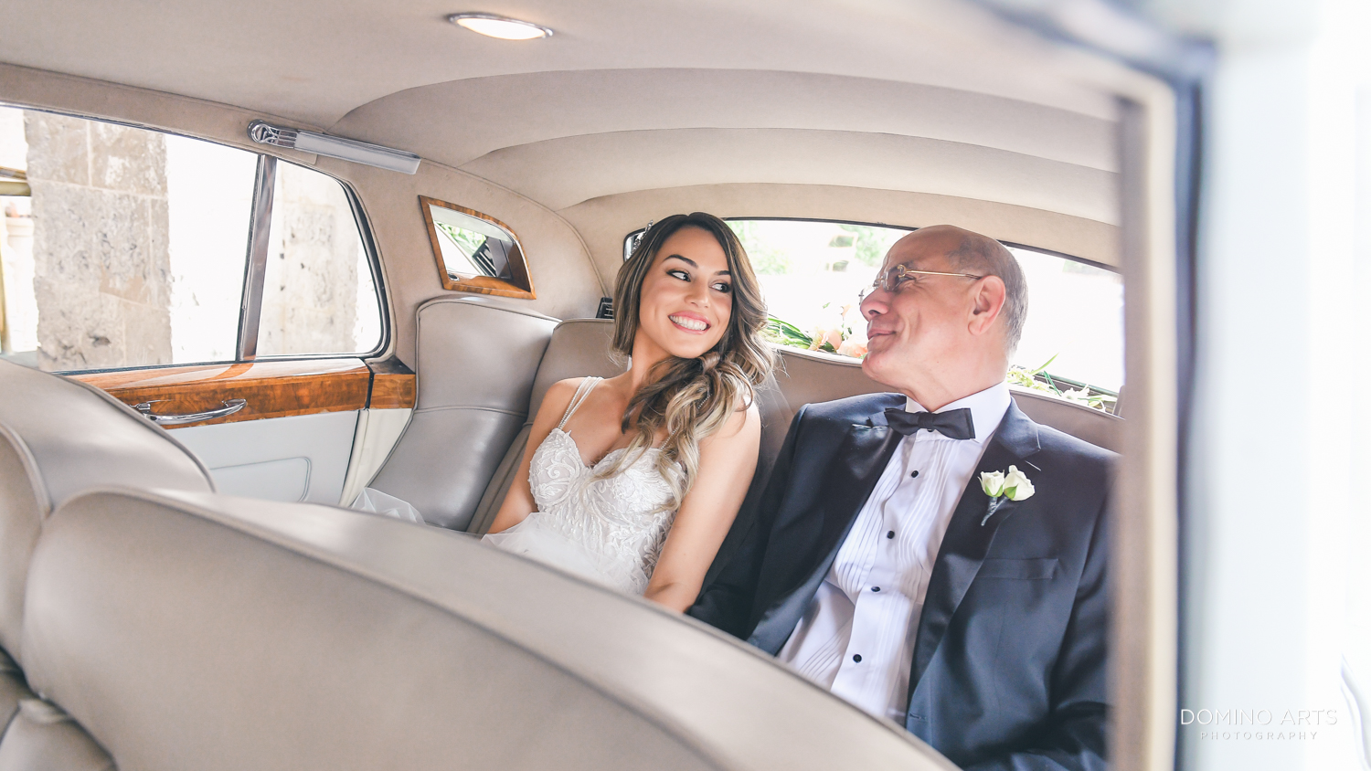 Bride and dad in a vintage car going to Ascension Catholic Church