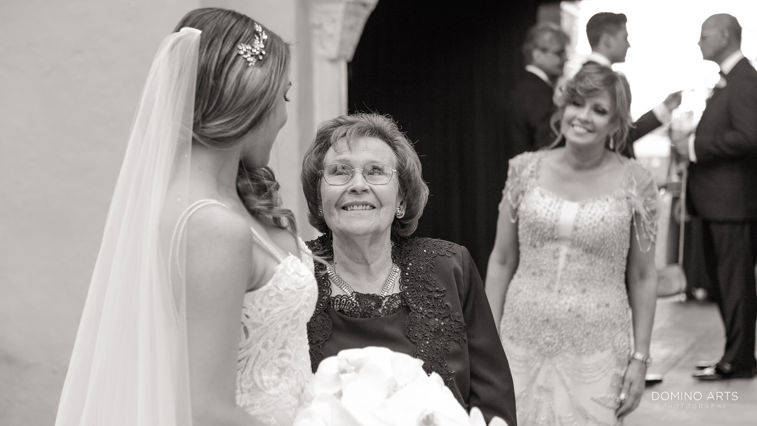 A three-generation picture of a bride with her mom and grandmother at Boca Raton Resort
