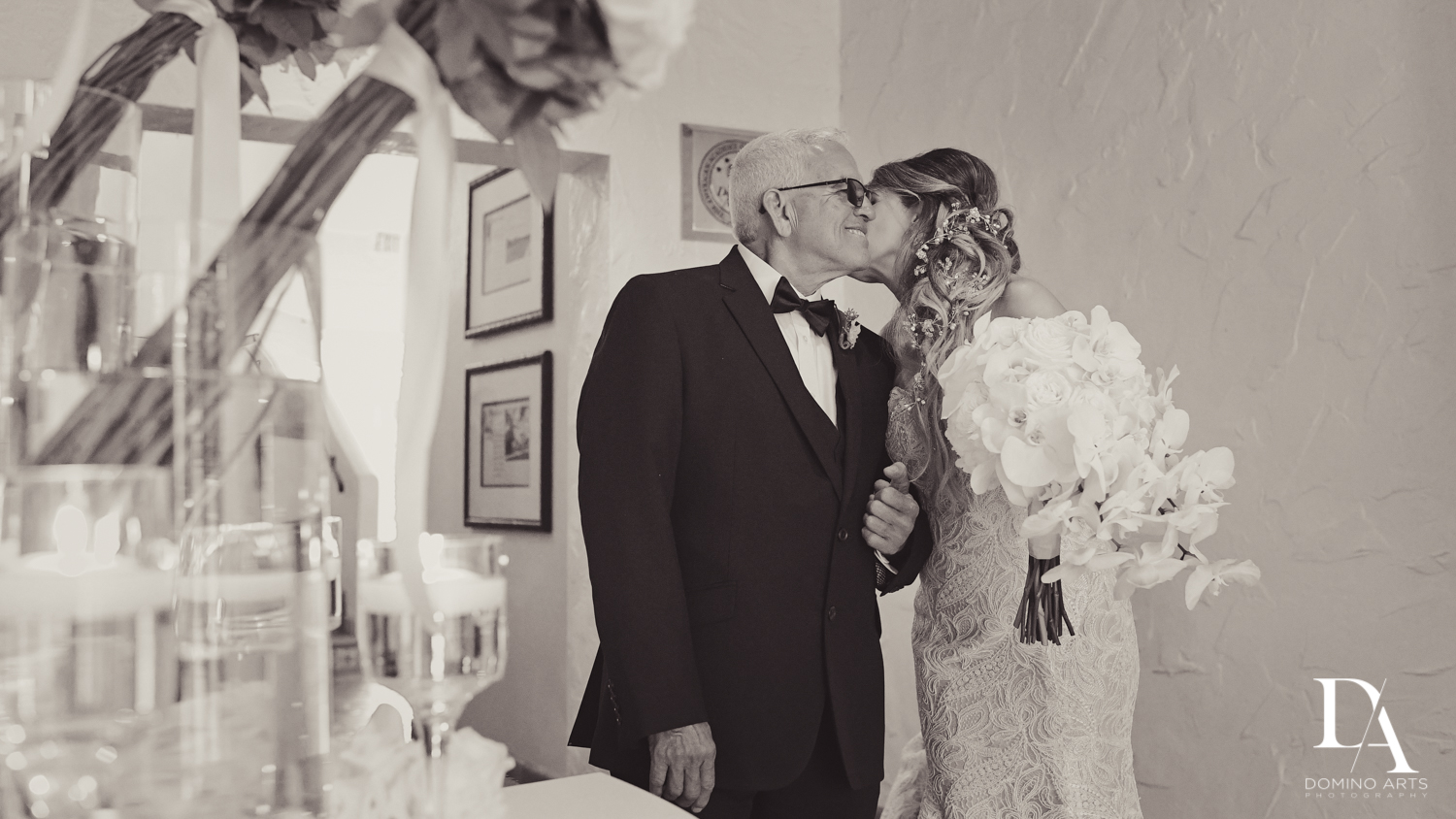 Bride and her father last kiss before walking down the aisle at The Addison Boca Raton