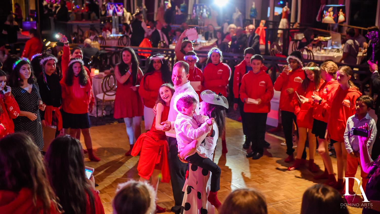 Fun family dancing at Broadway Theme Bat Mitzvah Photography at Miami Beach Resort