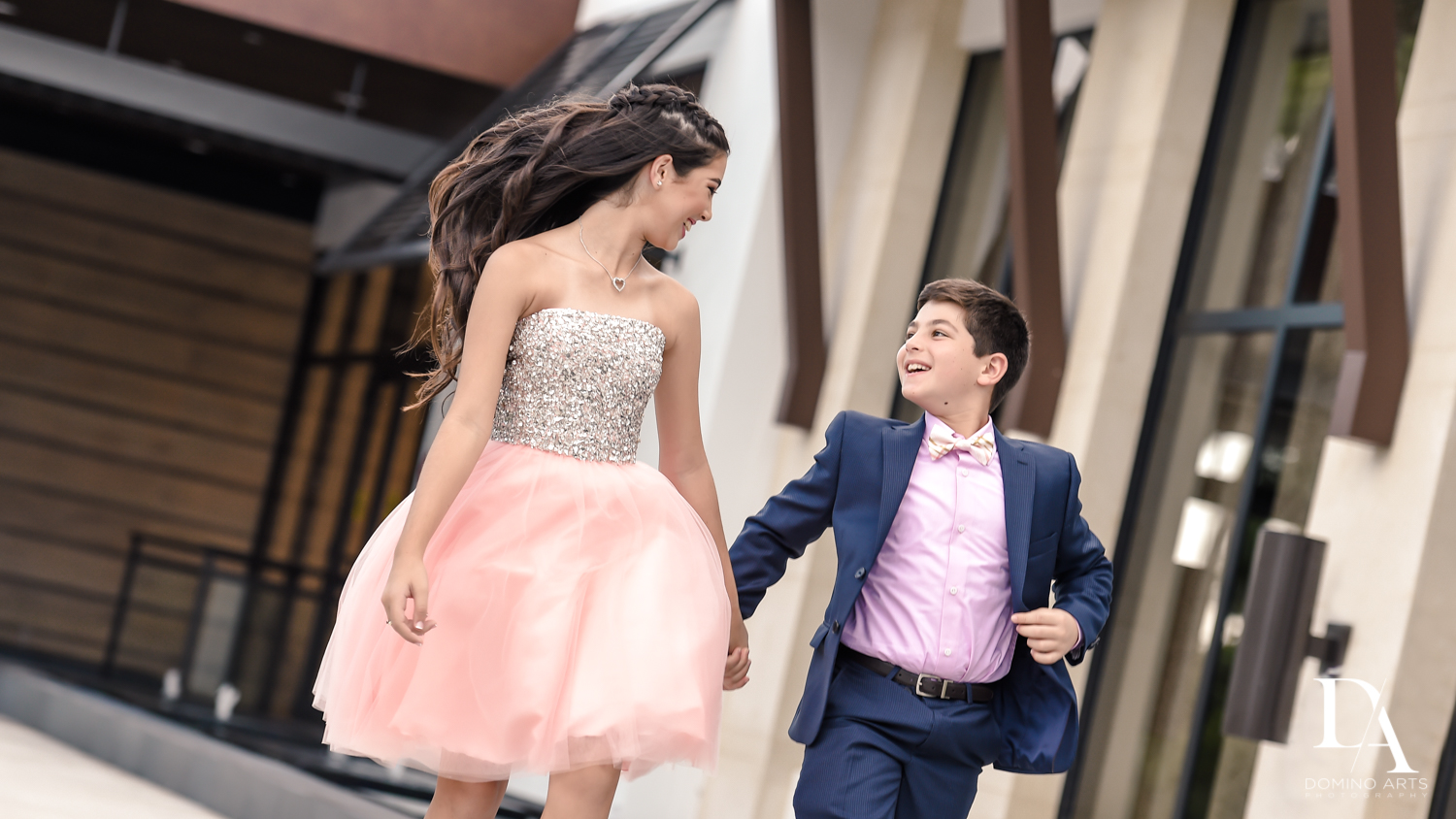 Natural family pictures of siblings at Saint Andrews Country Club South Florida by Domino Arts Photography
