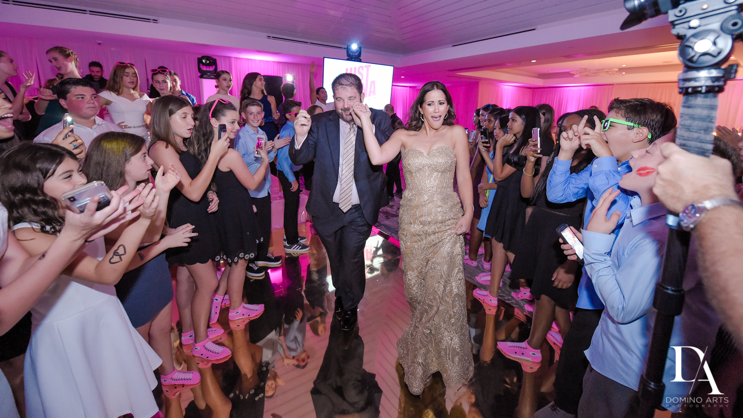 Fun party bat mitzvah pictures at Amazing trendy organic balloon decor at pink bat mitzvah at Saint Andrews Country Club South Florida by Domino Arts Photography
