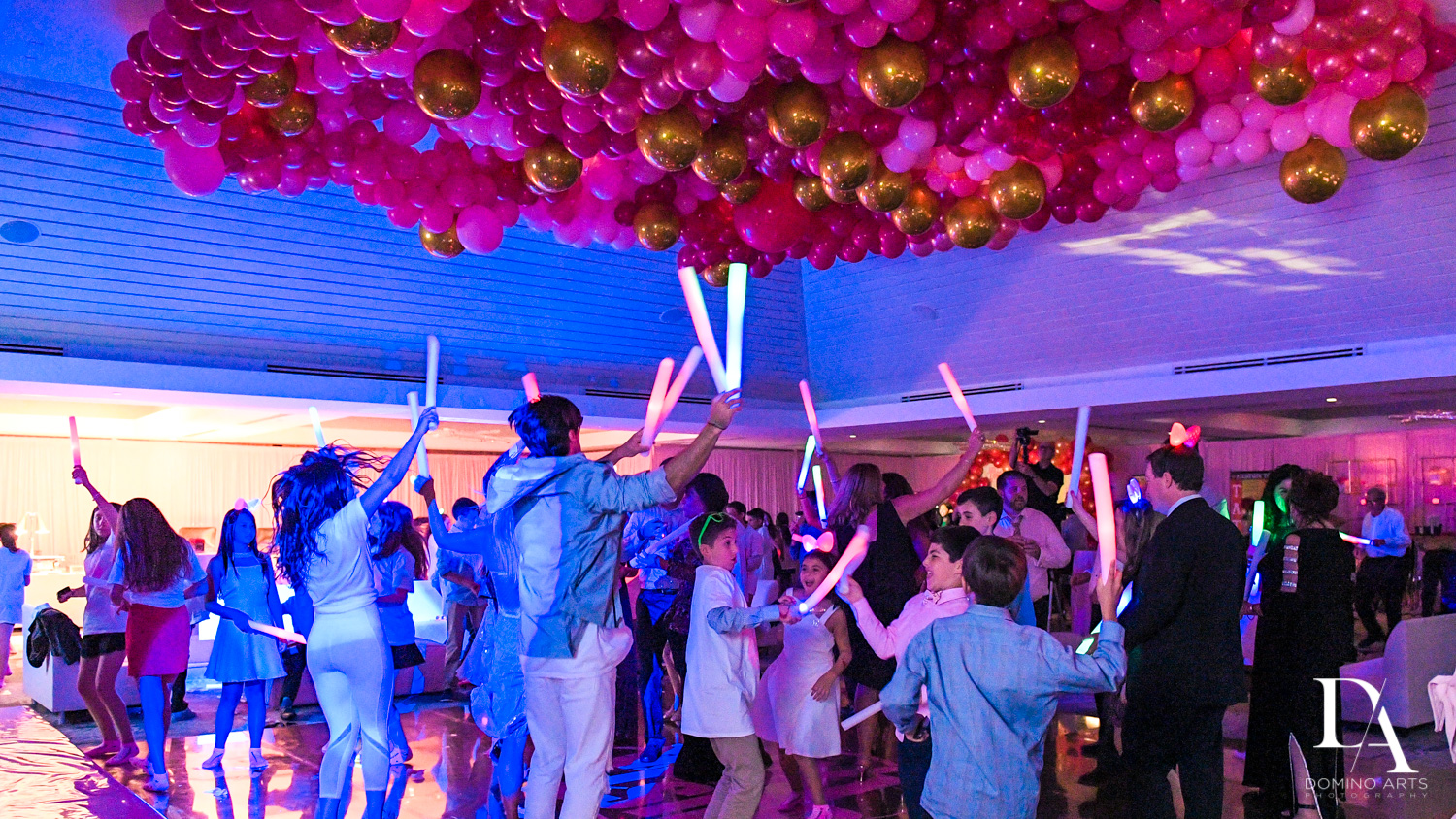 fun party with organic balloon decor neon at Bat Mitzvah at Saint Andrews Country Club South Florida by Domino Arts Photography