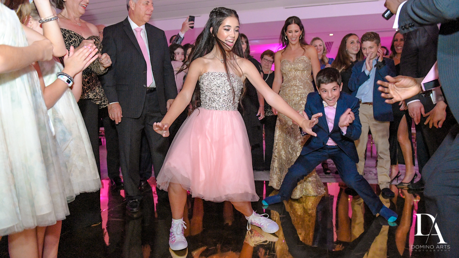 Fun dancing at party at Bat Mitzvah at Saint Andrews Country Club South Florida by Domino Arts Photography