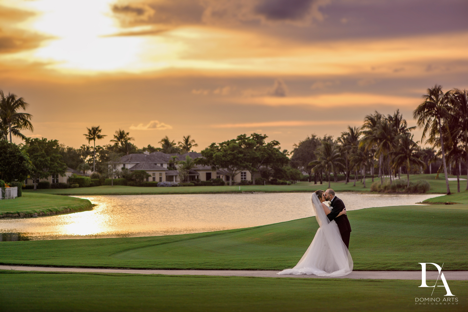Couple kissing at Romantic Outdoors Wedding at Woodfield Country Club in Boca Raton, Florida