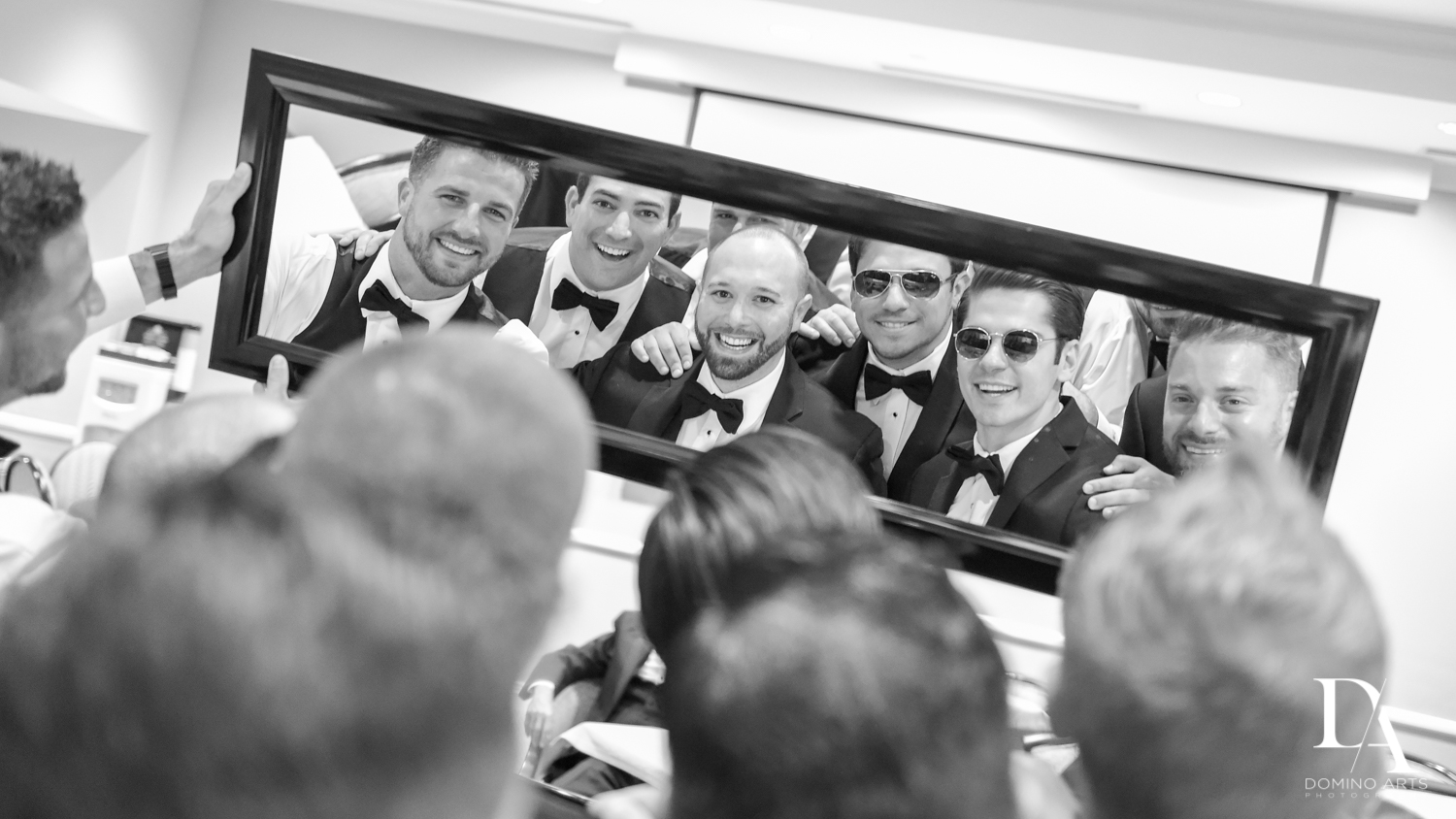 Groom and groomsmen getting ready at Romantic Outdoors Wedding at Woodfield Country Club in Boca Raton, Florida