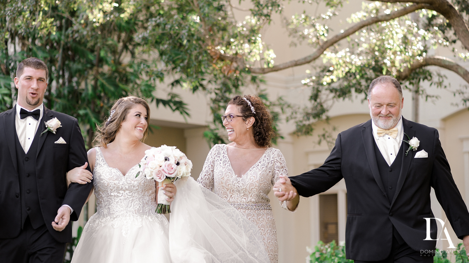Candid family pictures at Romantic Outdoors Wedding at Woodfield Country Club in Boca Raton, Florida