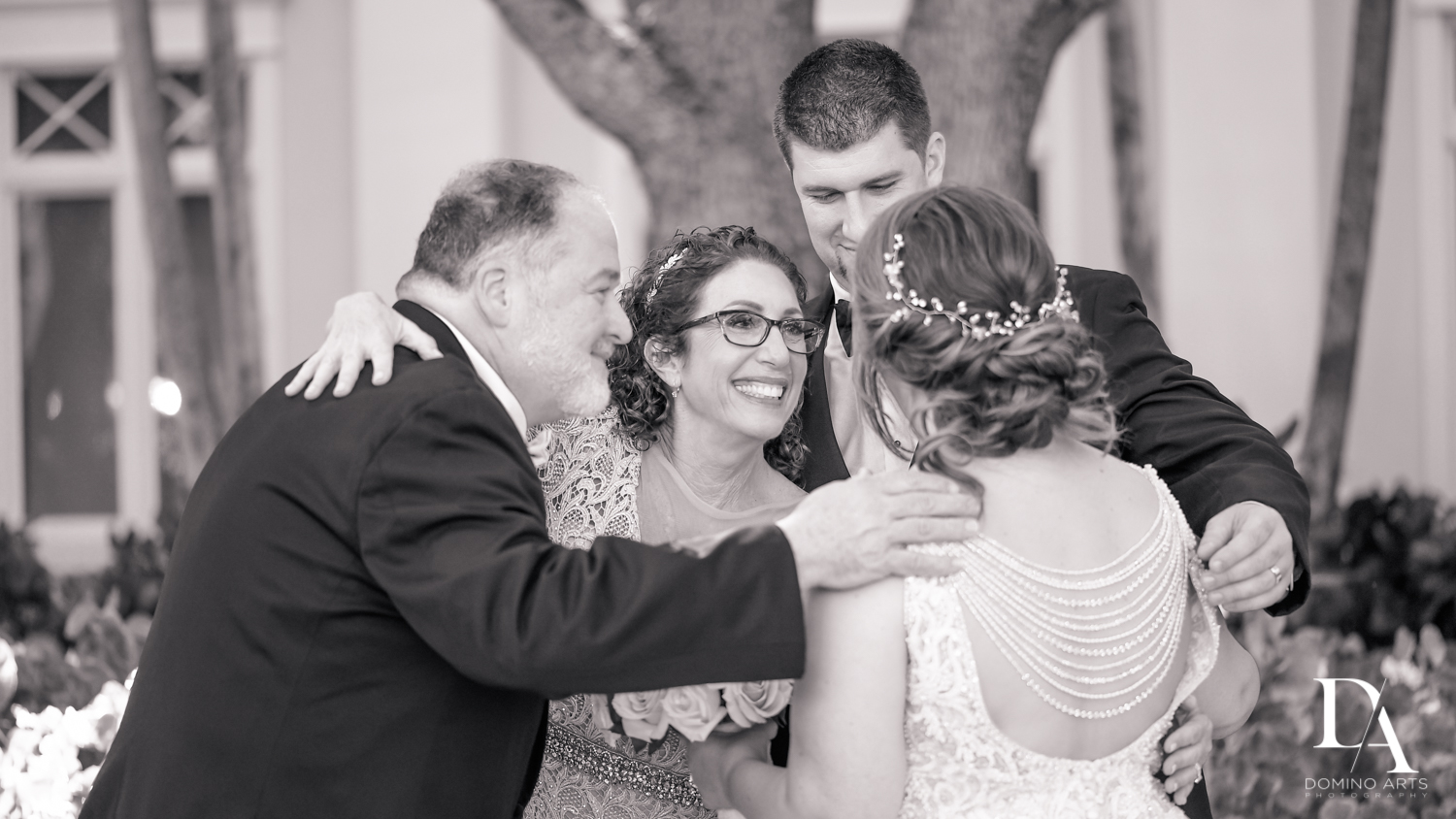 Candid family photo at Romantic Outdoors Wedding at Woodfield Country Club in Boca Raton, Florida by Domino Arts Photography
