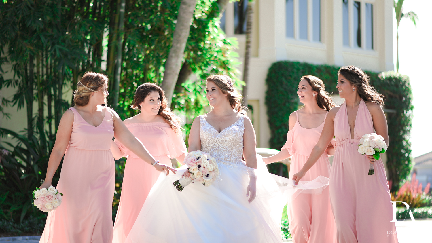 Candid bridesmaids at Romantic Outdoors Wedding at Woodfield Country Club in Boca Raton, Florida by Domino Arts Photography