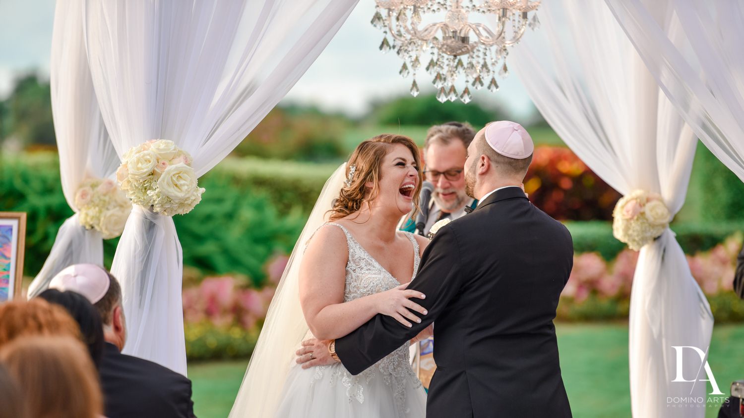 Fun candid pics at Romantic Outdoors Wedding at Woodfield Country Club in Boca Raton, Florida by Domino Arts Photography
