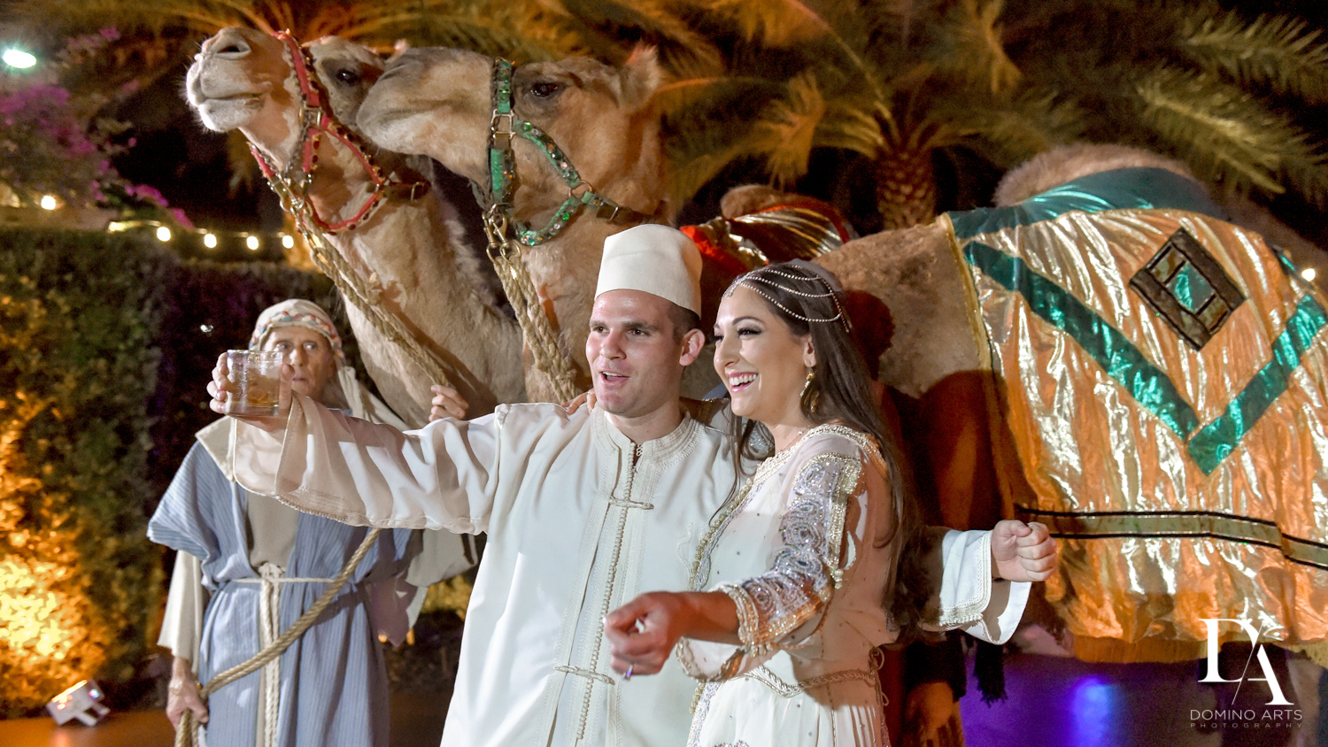 bride and groom with camels at Traditional Henna Party Photography at Lavan South Florida by Domino Arts