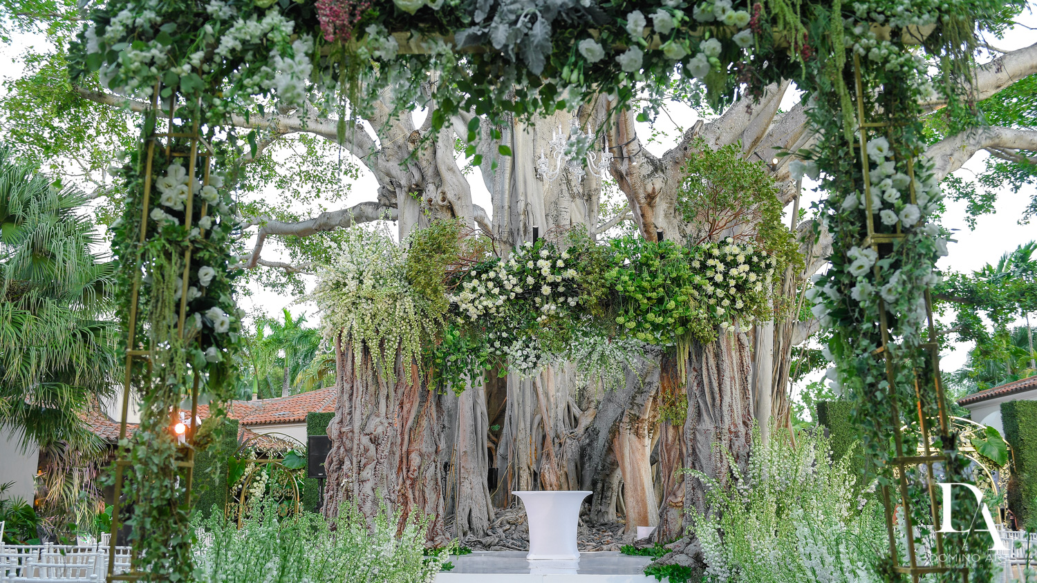 floral chuppah at Luxurious Destination Wedding at Fisher Island Miami by Domino Arts Photography