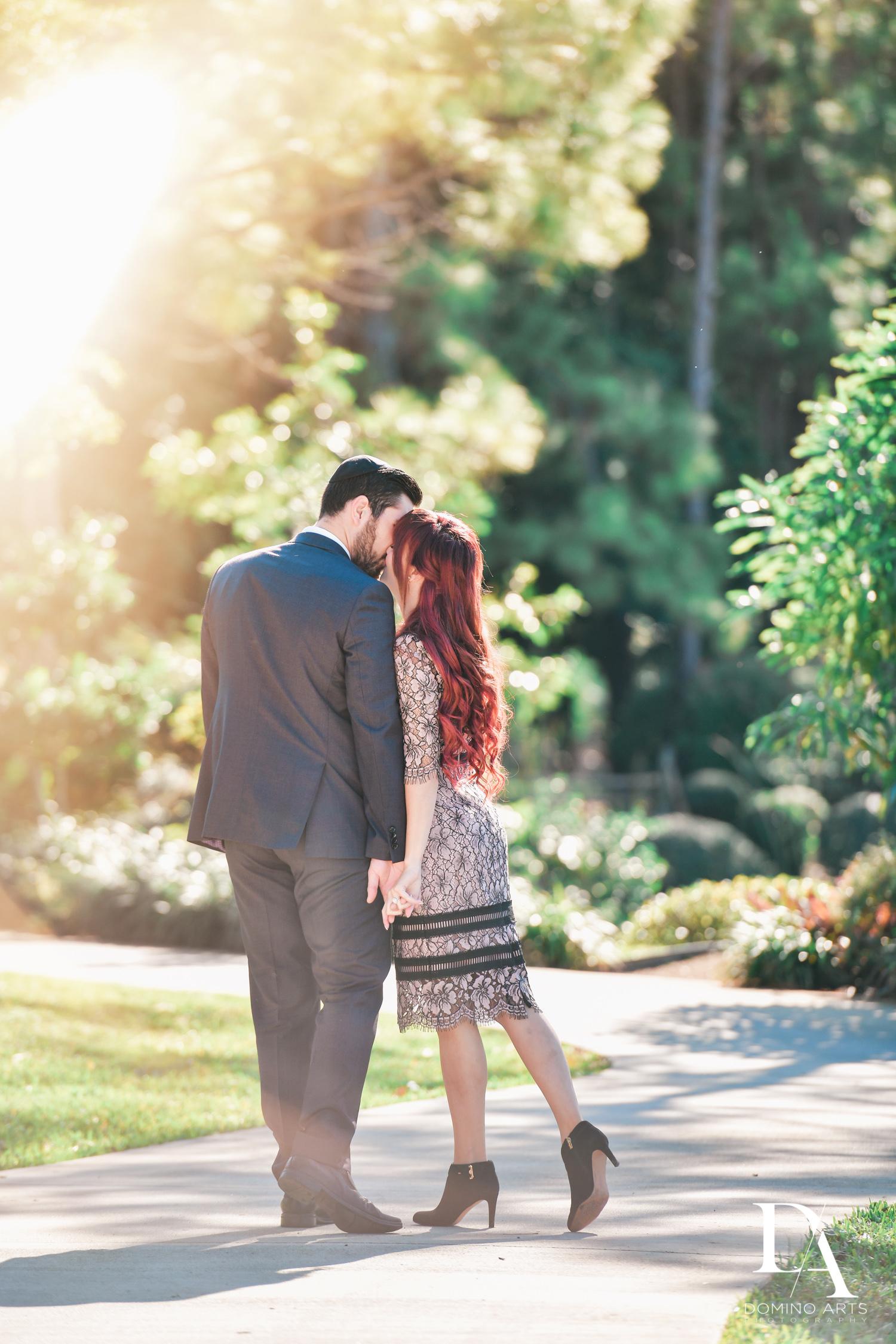 Kissing at Japanese Garden Engagement at Morikami by Domino Arts Photography