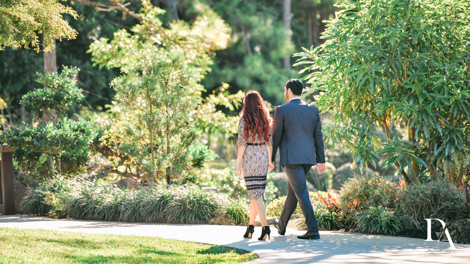 Holding hands at Japanese Garden Engagement at Morikami by Domino Arts Photography
