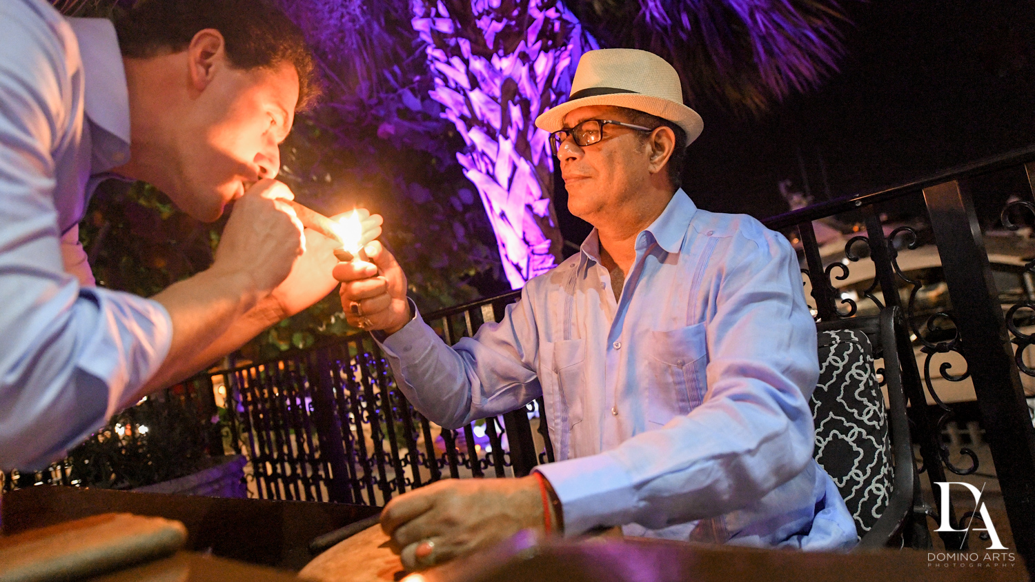 cuban cigar roller at Classic & Elegant Wedding at Fisher Island Miami by Domino arts Photography