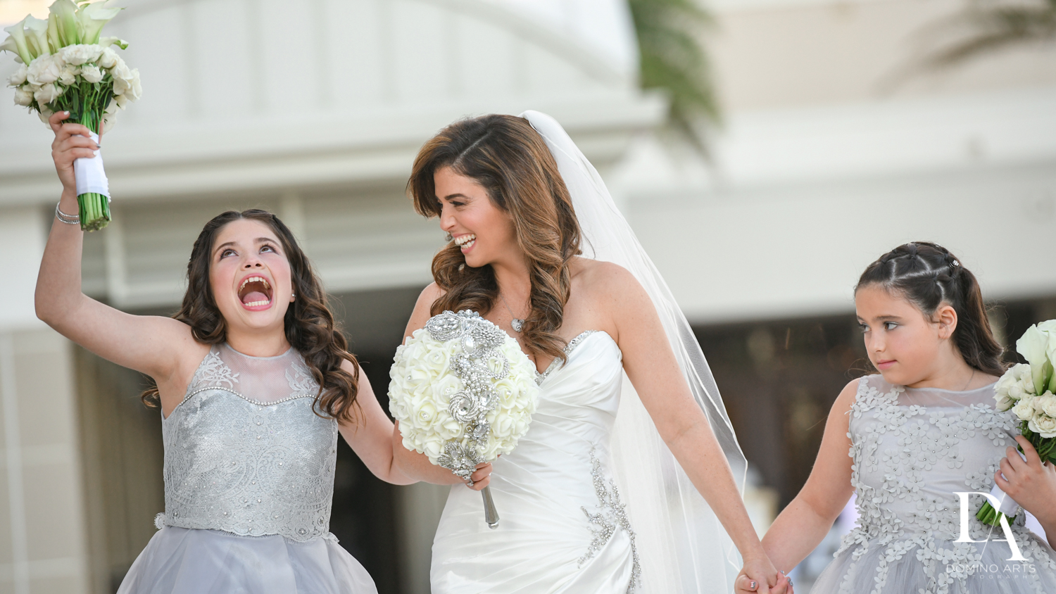 Girls having fun at Wedding Photography in South Florida at Fort Lauderdale Marriott Harbor Beach Resort & Spa by Domino Arts Photography