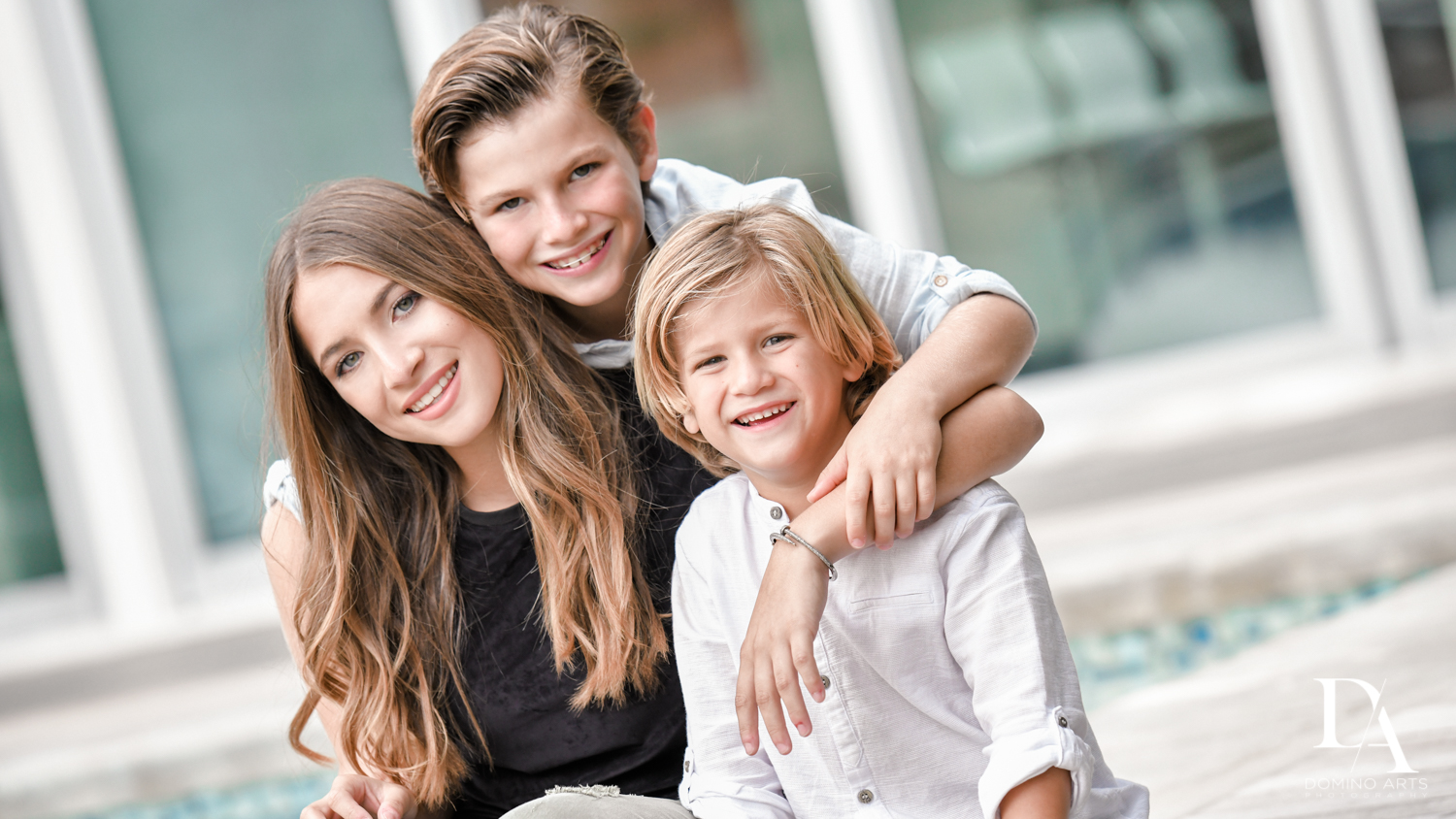 Siblings at Waterfront Photo Session in Miami by Domino Arts Photography