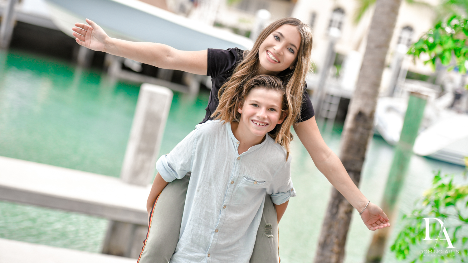 fun siblings at Waterfront Photo Session in Miami by Domino Arts Photography