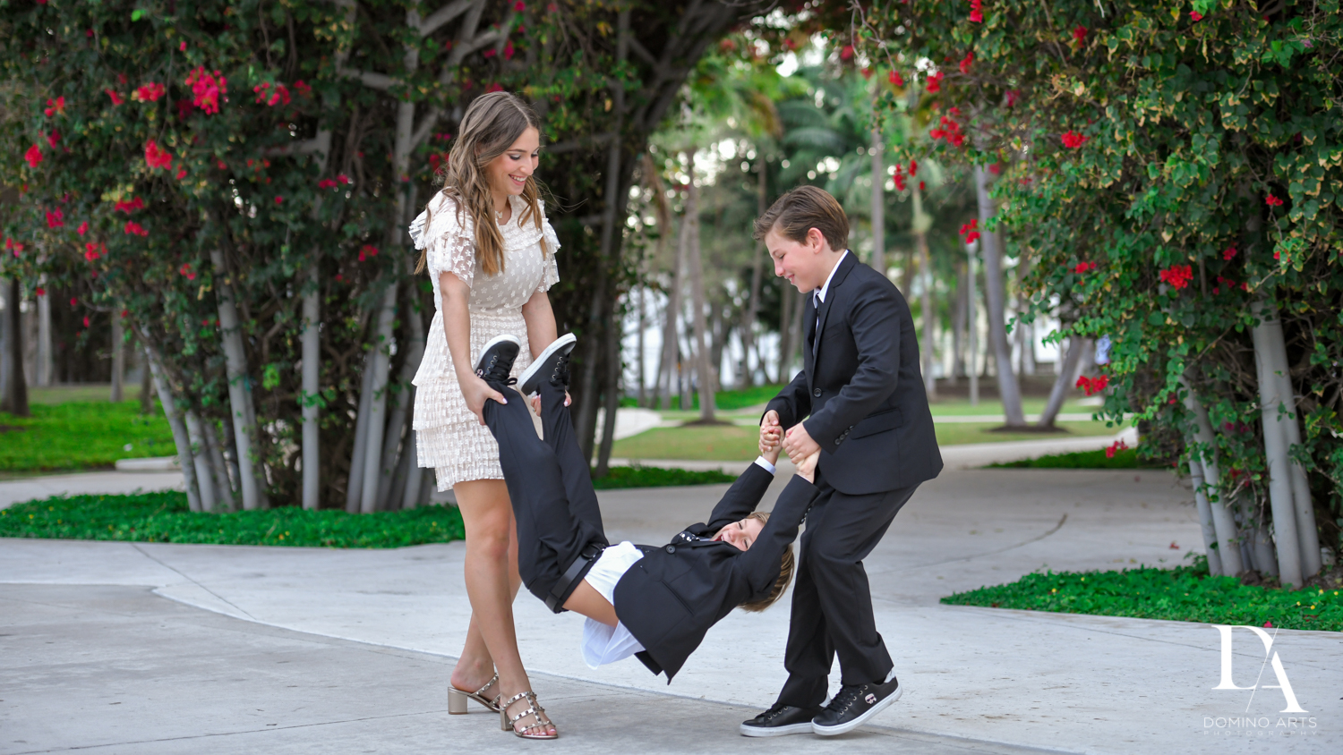siblings pictures at Luxurious Broadway Theme Bat Mitzvah at New World Symphony in Miami Beach by Domino Arts Photography