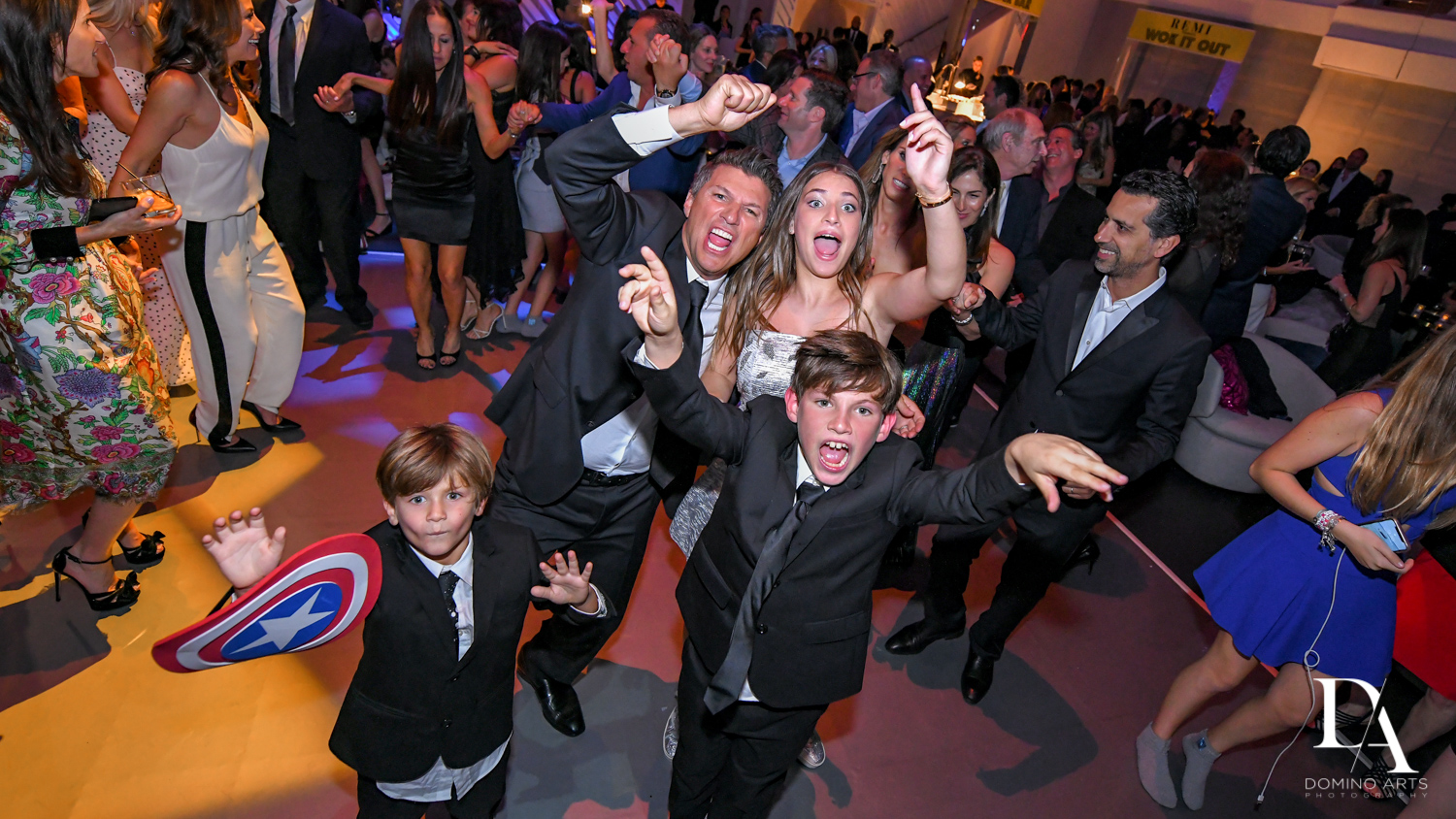 fun family photos at Luxurious Broadway Theme Bat Mitzvah at New World Symphony in Miami Beach by Domino Arts Photography