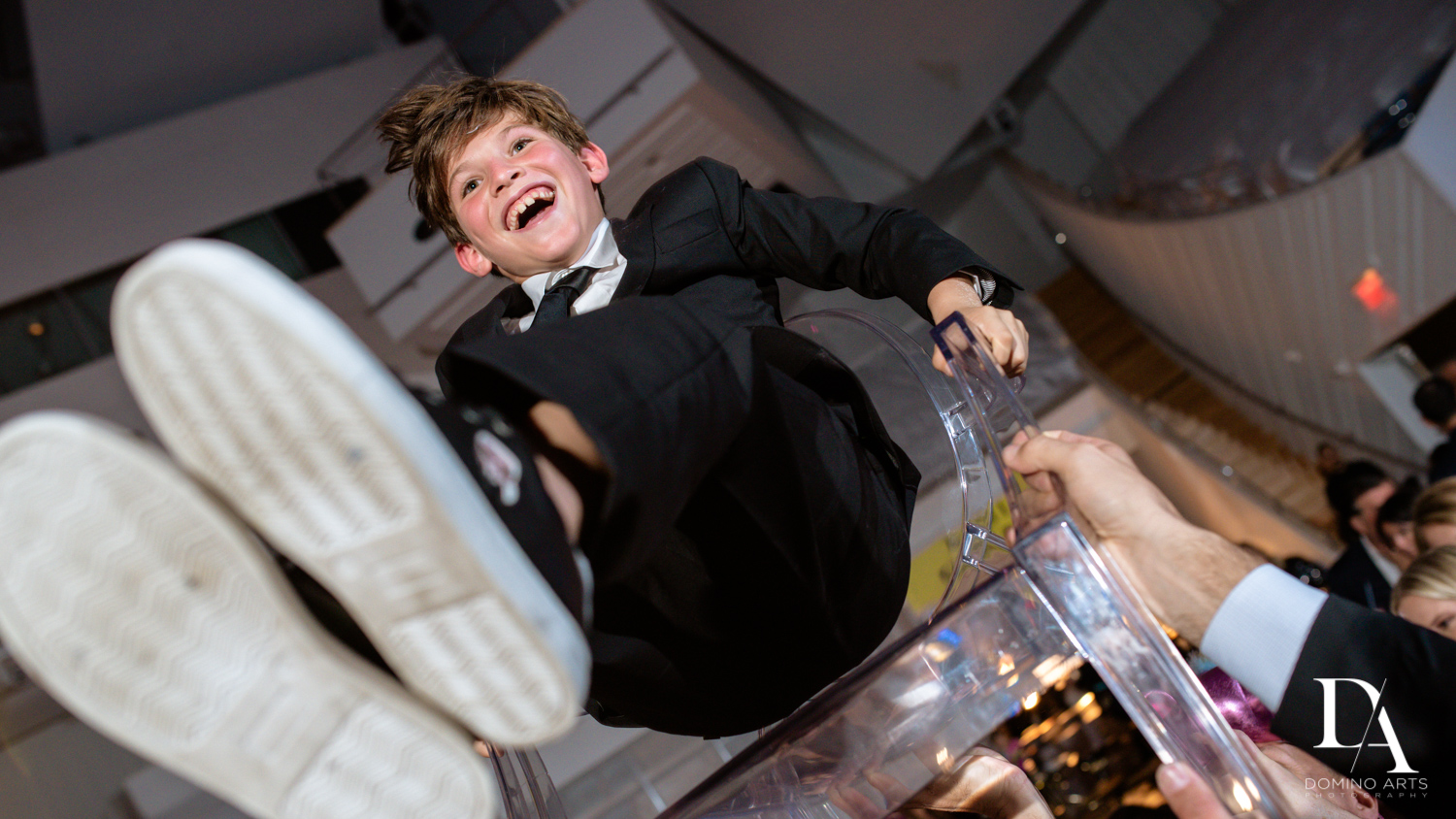 fun hora pictures at Luxurious Broadway Theme Bat Mitzvah at New World Symphony in Miami Beach by Domino Arts Photography