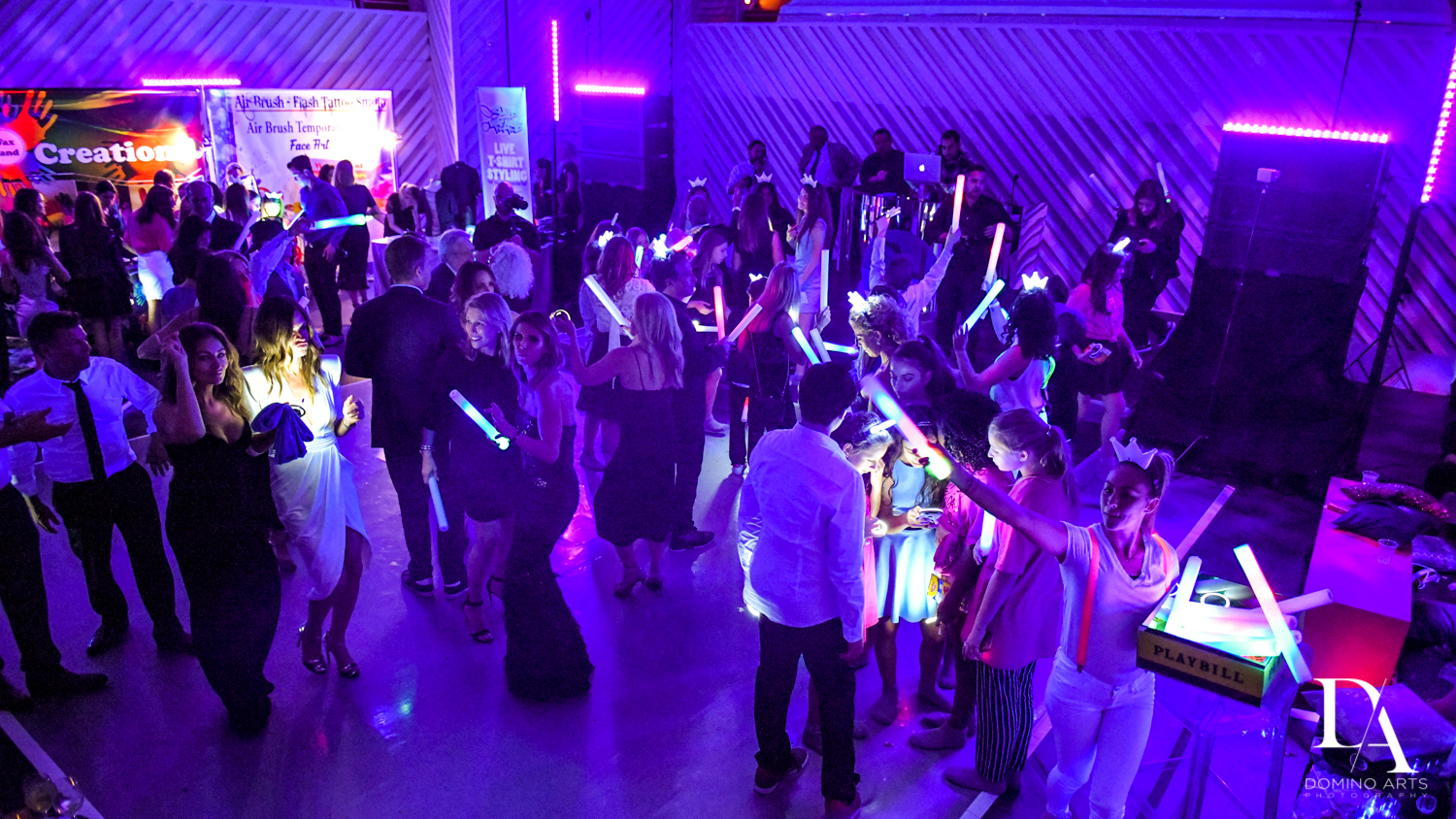 neon party at Luxurious Broadway Theme Bat Mitzvah at New World Symphony in Miami Beach by Domino Arts Photography