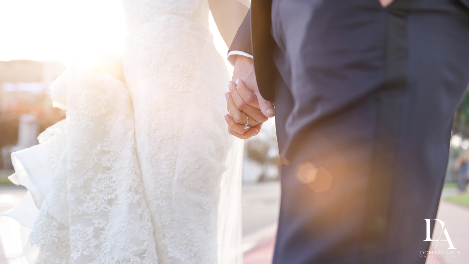 Romantic holding hands at Classic Miami Beach Wedding at Temple Emanu-El and Emanuel Luxury Venue by Domino Arts Photography