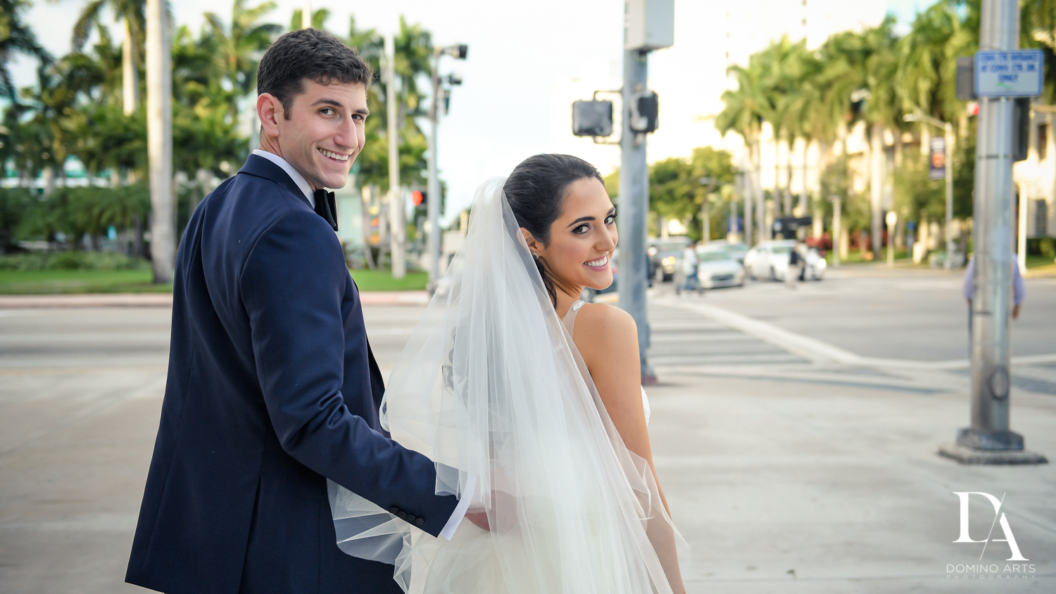 natural bride and groom pics at Classic Miami Beach Wedding at Temple Emanu-El and Emanuel Luxury Venue by Domino Arts Photography