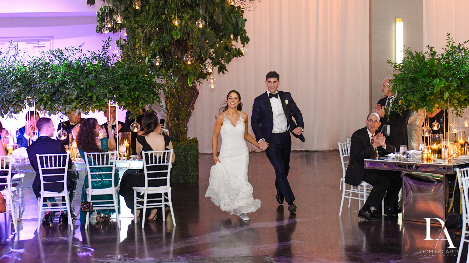 bride and groom grand entrance at Classic Miami Beach Wedding at Temple Emanu-El and Emanuel Luxury Venue by Domino Arts Photography