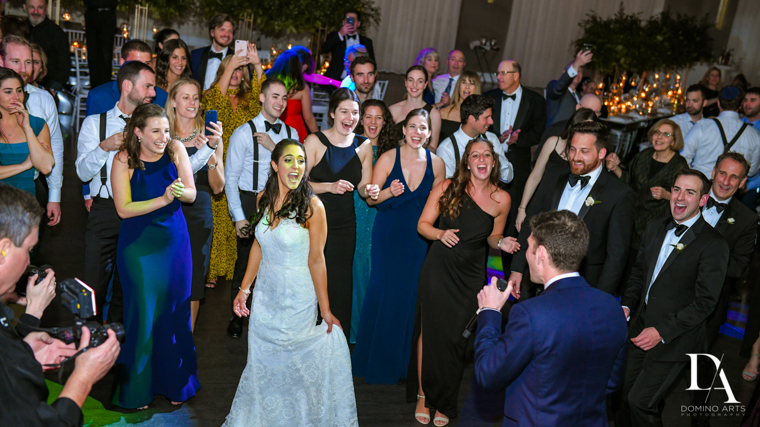 party fun at Classic Miami Beach Wedding at Temple Emanu-El and Emanuel Luxury Venue by Domino Arts Photography