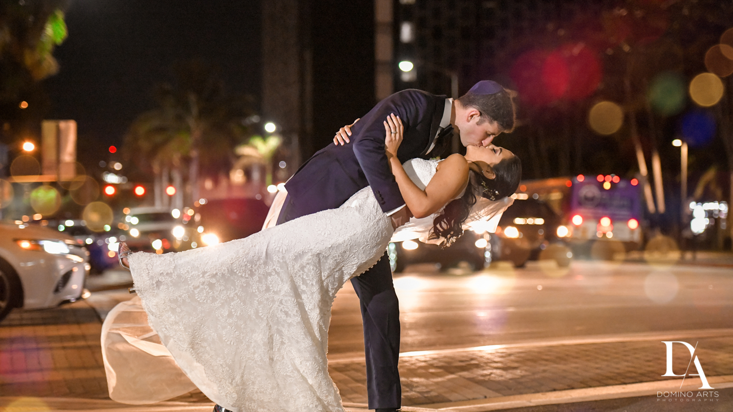 kiss at Classic Miami Beach Wedding at Temple Emanu-El and Emanuel Luxury Venue by Domino Arts Photography