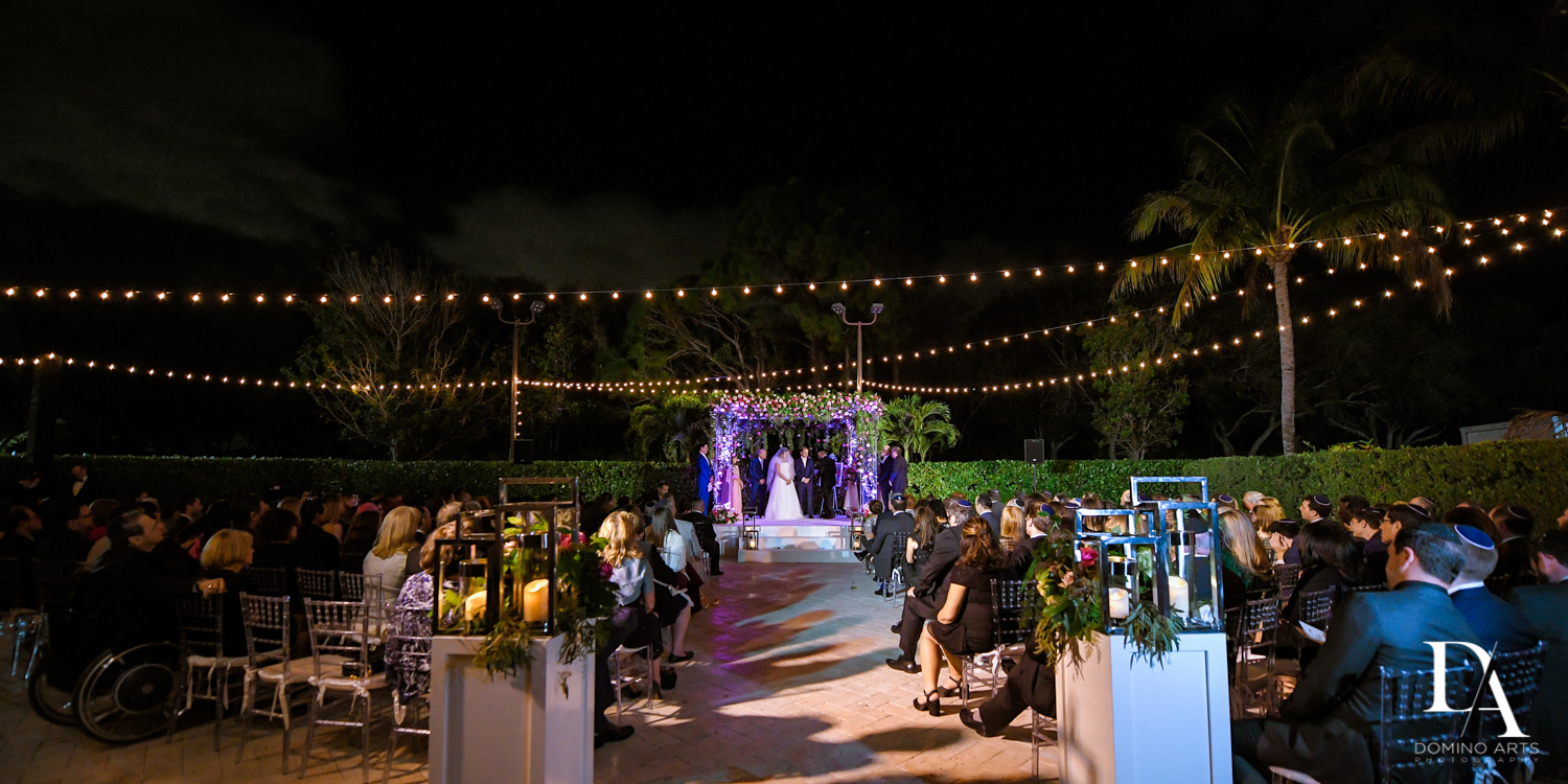 night time ceremony at Fairy-Tale Wedding at BNai Torah Boca Raton by Domino Arts Photography