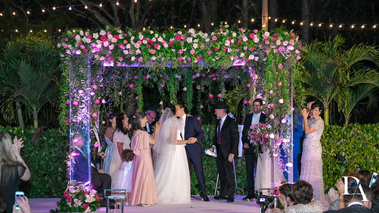 kiss under chuppah at Fairy-Tale Wedding at BNai Torah Boca Raton by Domino Arts Photography