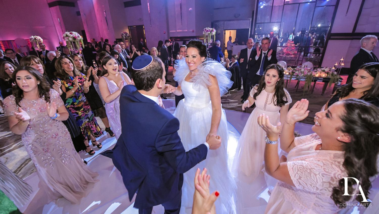 hora at Fairy-Tale Wedding at BNai Torah Boca Raton by Domino Arts Photography