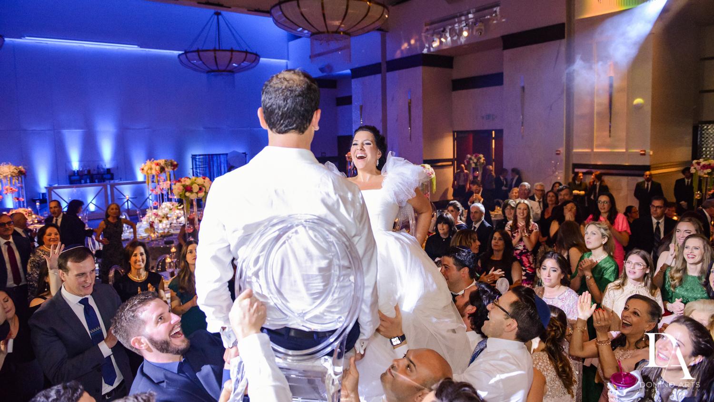 Fun hora at Fairy-Tale Wedding at BNai Torah Boca Raton by Domino Arts Photography