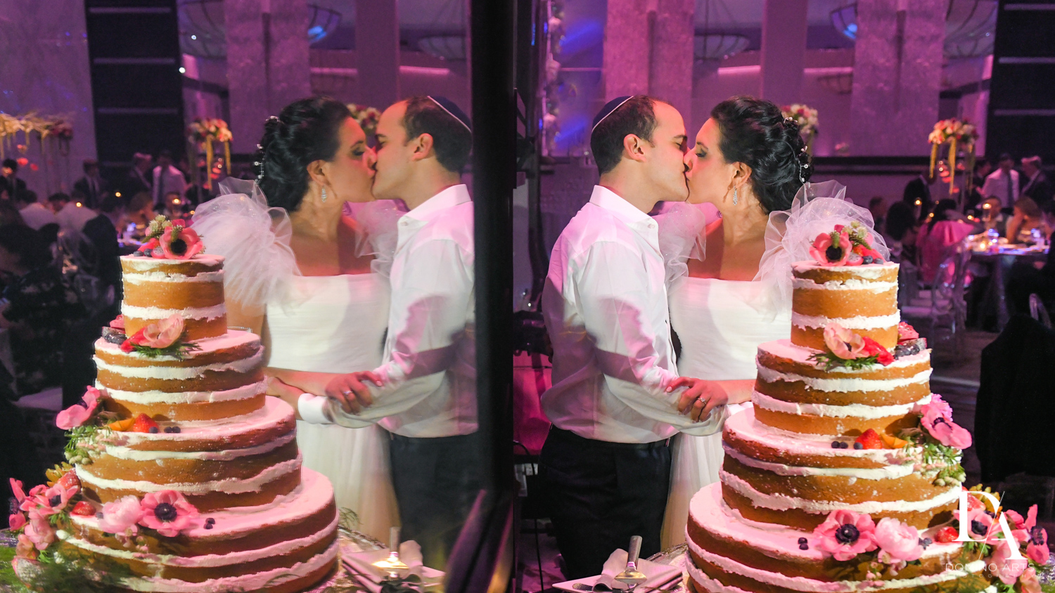 kissing by cake at Fairy-Tale Wedding at BNai Torah Boca Raton by Domino Arts Photography