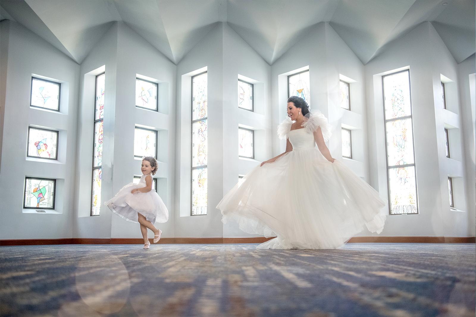 Bride and flower girl swirling