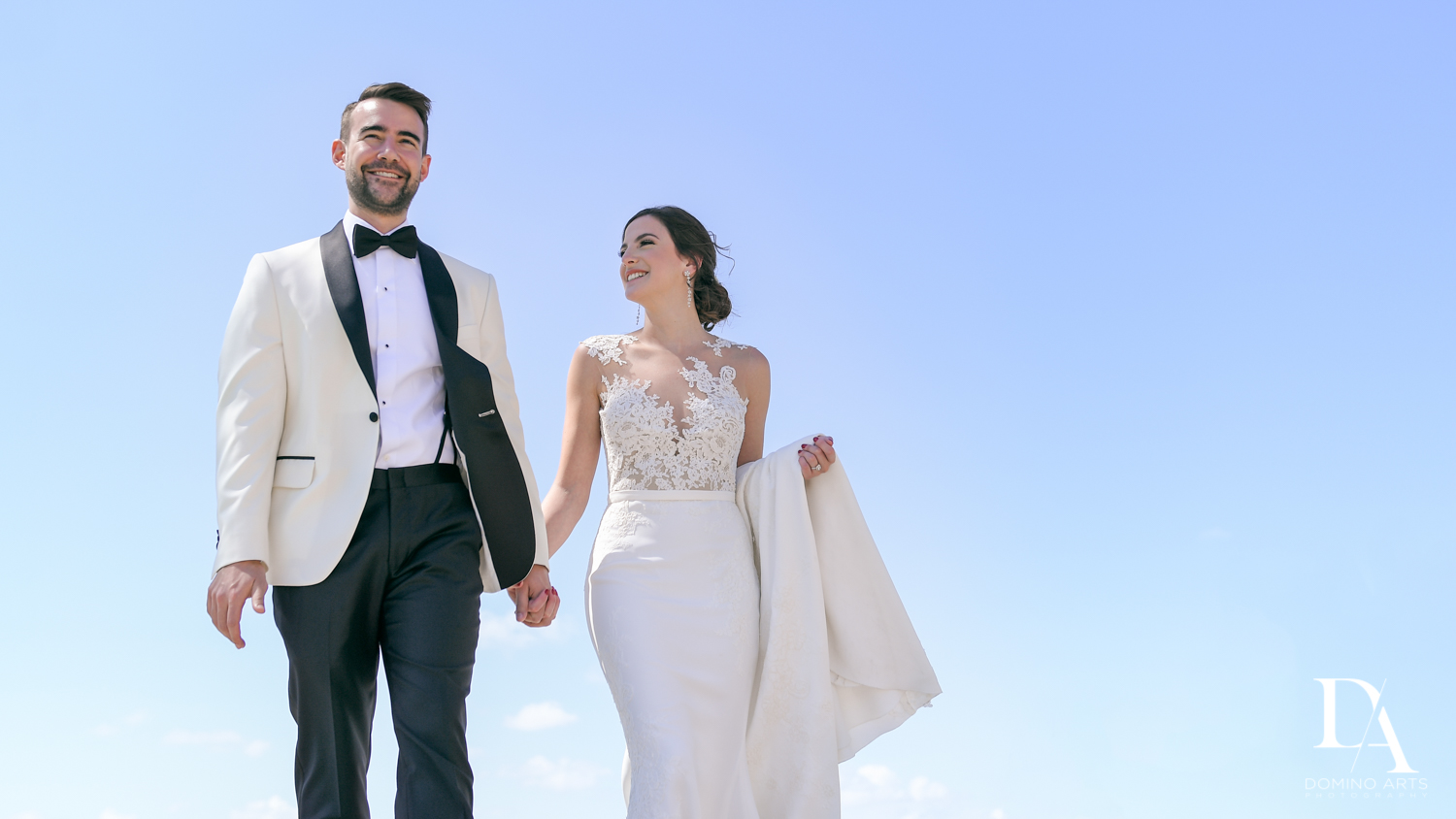 bride and groom at Tropical Garden Wedding at Fisher Island Miami by Domino Arts Photography