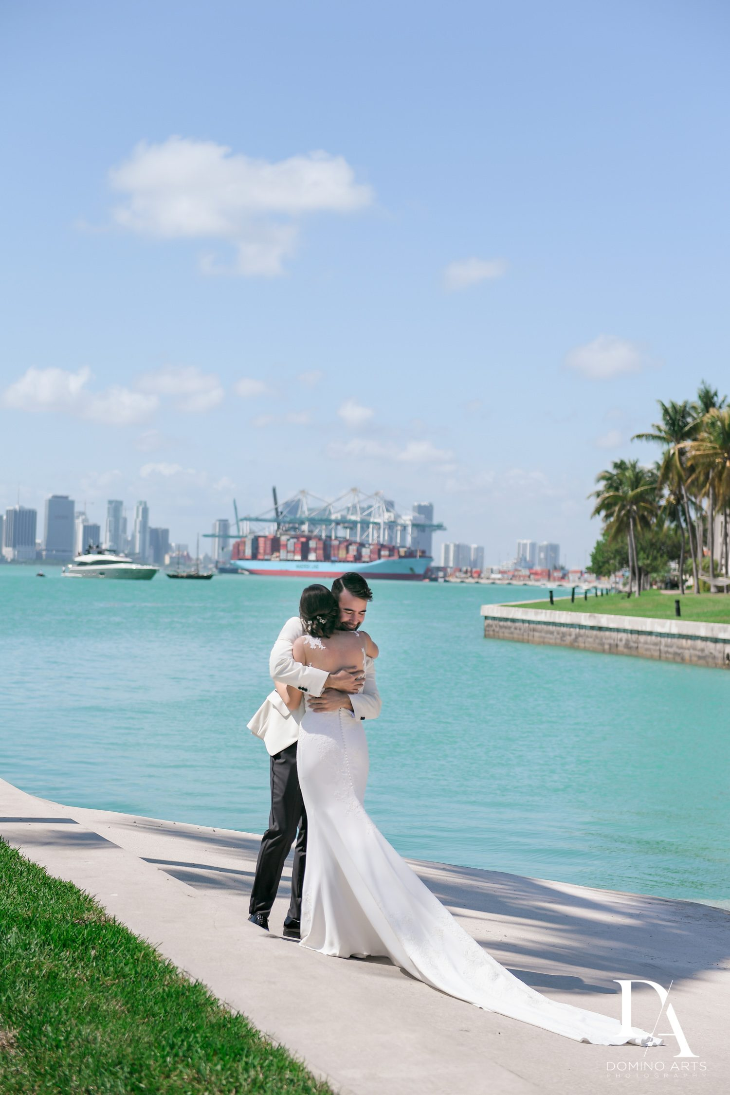 miami skyline romantic pictures at Tropical Garden Wedding at Fisher Island Miami by Domino Arts Photography