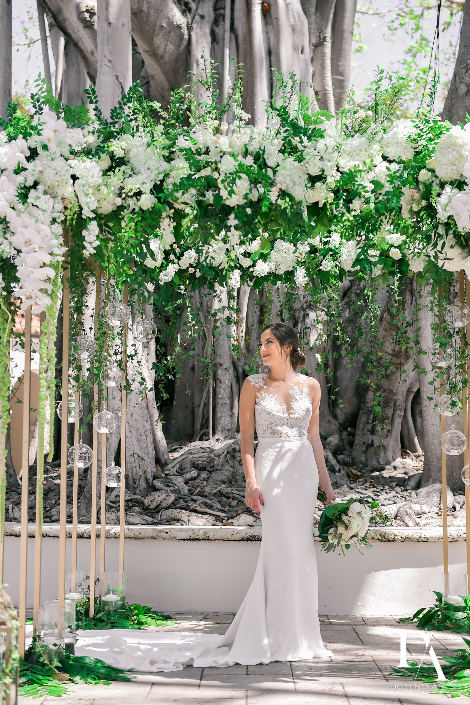 flower chuppah at Tropical Garden Wedding at Fisher Island Miami by Domino Arts Photography